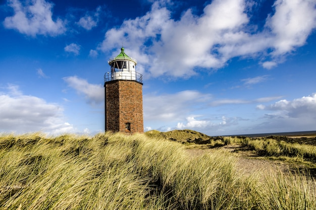 Lighthouse quermarkenfeuer in kampen, sylt, germany under the cloudy sky