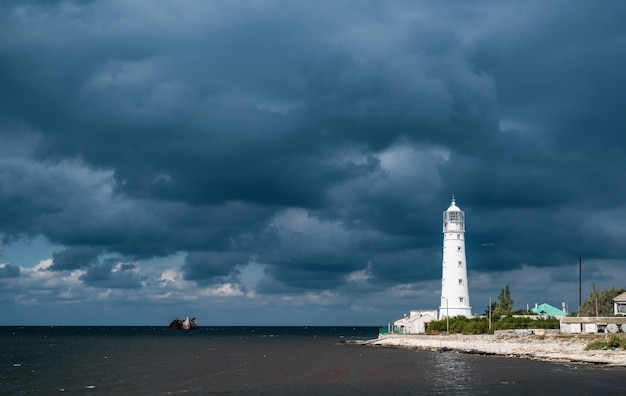 Lighthouse on rain clouds