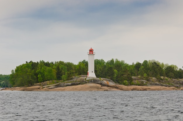 Lighthouse on a rocky island in the baltic sea.