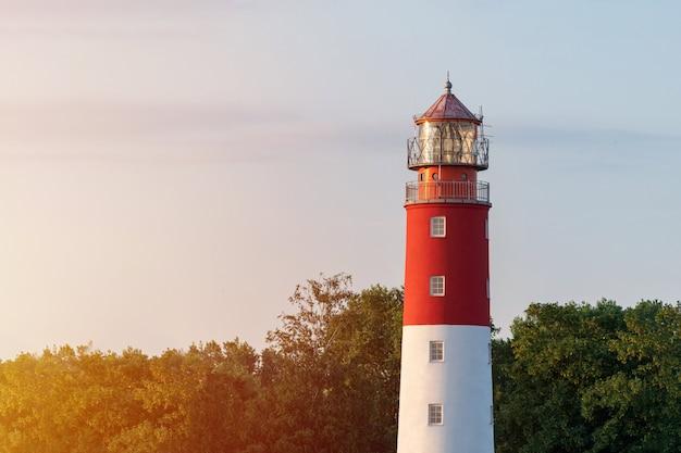 Lighthouse in seaport. beautiful russian baltiysk beacon. scenery blue sky, copy space.