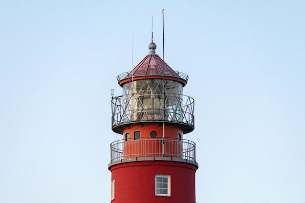 Lighthouse in seaport
