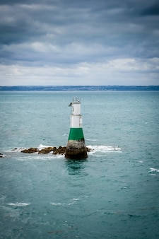 Lighthouse and seascape in pleneuf val andre, brittany, france