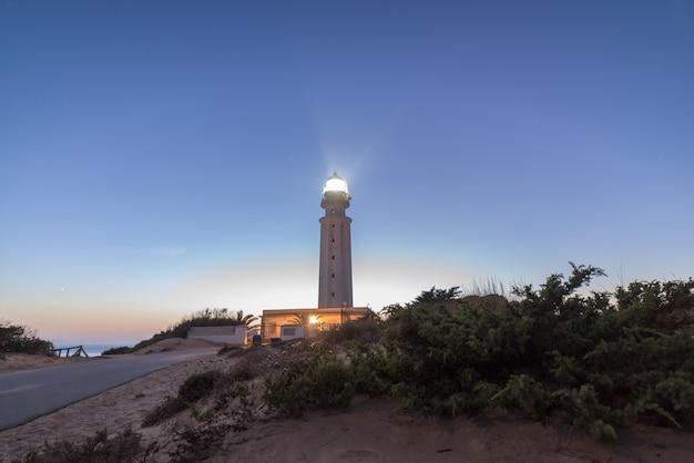 Lighthouse of trafalgar illuminated at nightfall