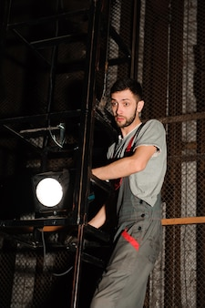 The lighting engineer adjusts the lights on stage behind the scenes.