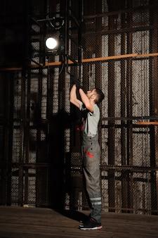 The lighting engineer adjusts the lights on stage