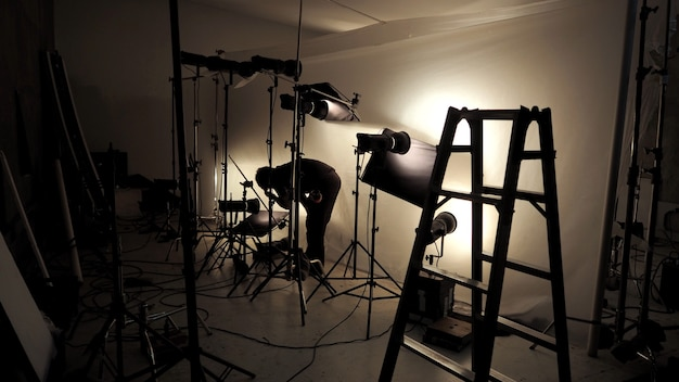 Lighting setup in studio for commercial works such as photo movie or video film production