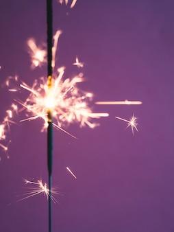 Lighting sparkler stick in studio
