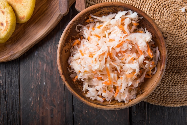 Lightly fermented cabbage relish with pupusa