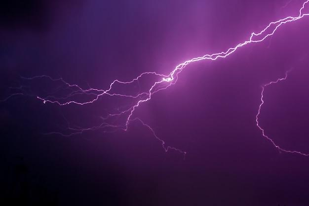 Lightning in the dark sky during a thunderstorm night