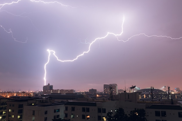 Lightning from thunder hits the city in bangkok , thailand