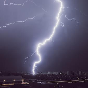 Lightning storm over the city at night.