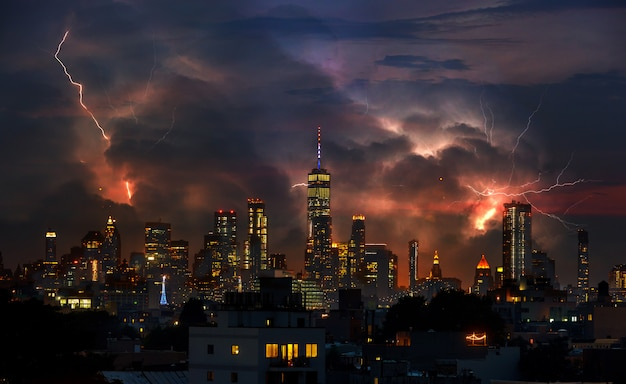 Lightning strike through new york city from brooklyn bridge perspective.