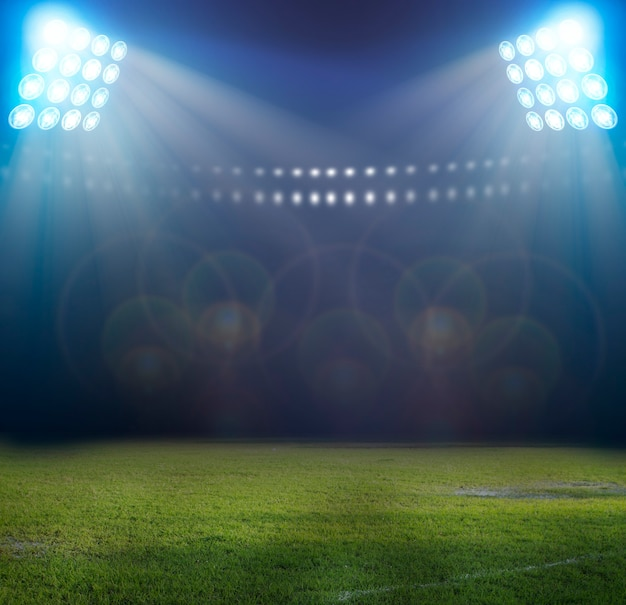 夜のライトとサッカースタジアム