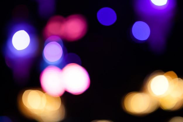 Огни размытым фоном боке от ночной вечеринки для вашего дизайна