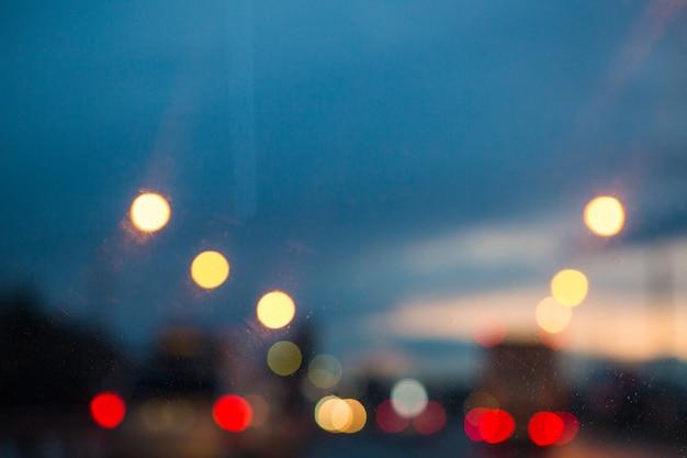 Lights bokeh on night road. night sky in city. blurred lights on road