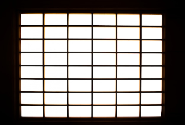 Lights shining into the room from the shoji screen window.