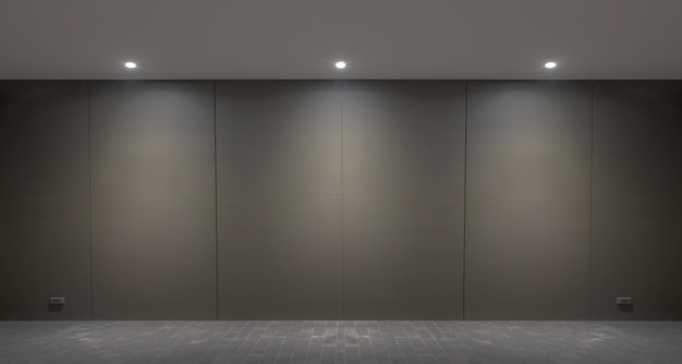 Lights wall and floor from lamp on the black wall background