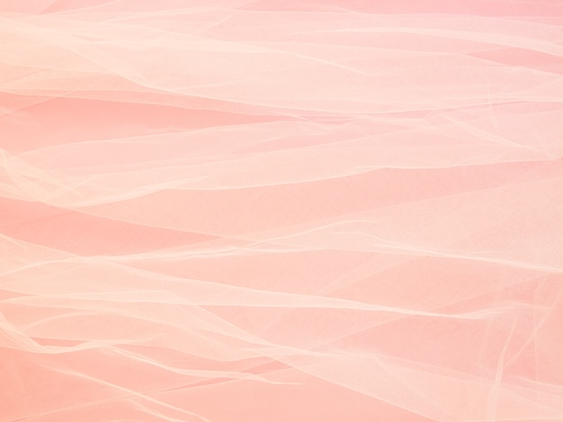 Lightweight fabric mesh lace on pink paper, texture of the fabric is beautifully draped background.