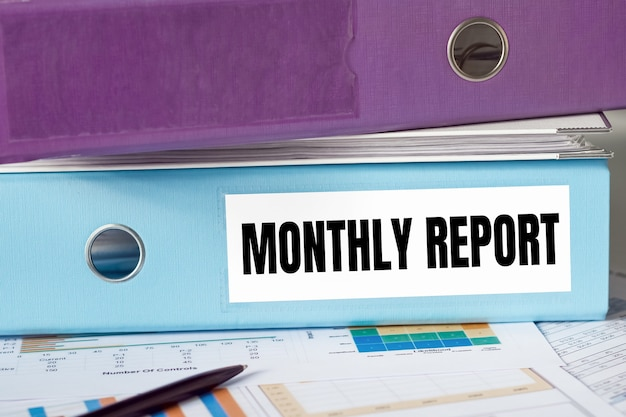 A lignt blue folder with the label monthly report.