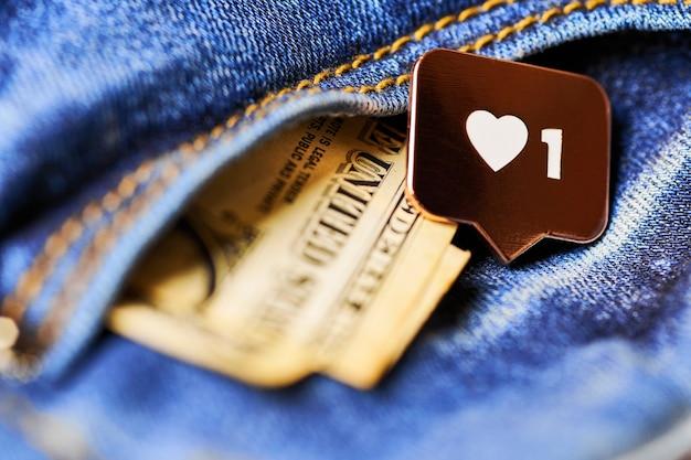 Как символ сердца и доллар в кармане джинсов. как кнопка знака, символ с сердцем и одной цифрой. маркетинг в социальных сетях.