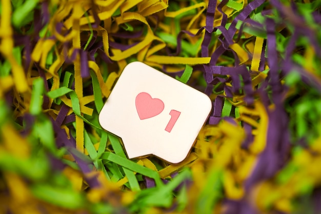 Like heart symbol. like sign button, symbol with heart and one digit. social media network marketing. multicolored tinsel background.