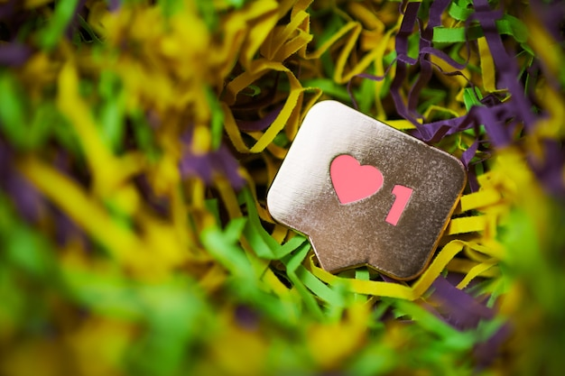 Like symbol. like sign button, symbol with heart and one digit. social media network marketing. multicolored tinsel background.