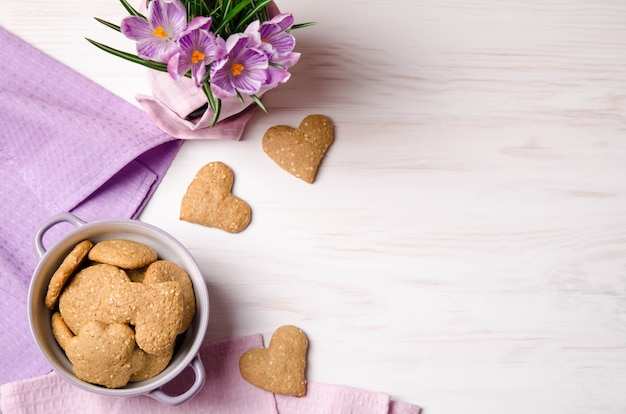 Lilac crocuses and sesame dry cookies