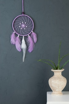 Lilac dream catcher on gray