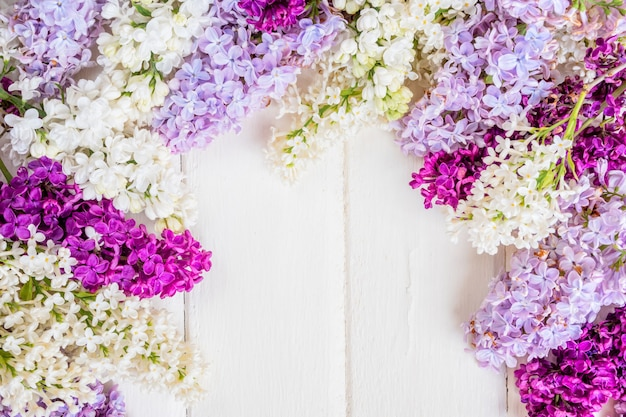 Lilac flowers branch on white wooden background with copyspace. spring or mother day concept