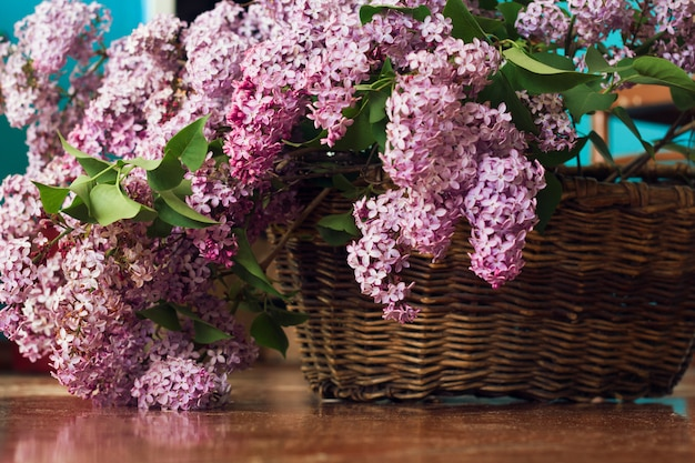 Lilac flowers bunch in a vintage brown basket