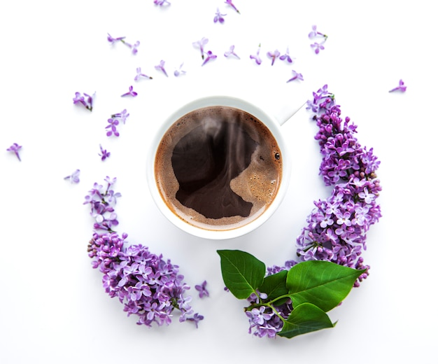 Lilac flowers and cup of coffee
