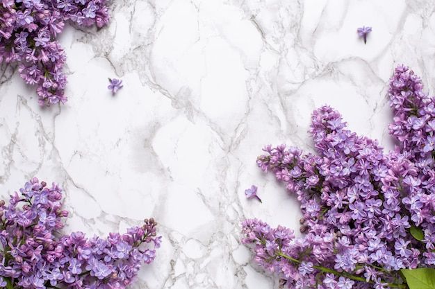 Lilac flowers on marble background with copyspace summer color and holiday concept.