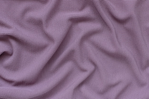 Lilac ribbed corduroy texture wall with waves.