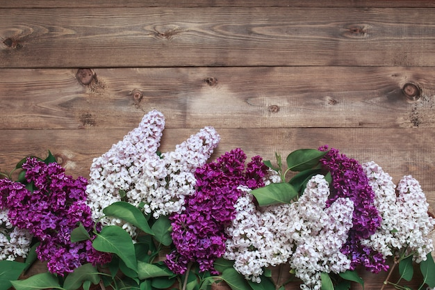 Liliac flowers on wooden background