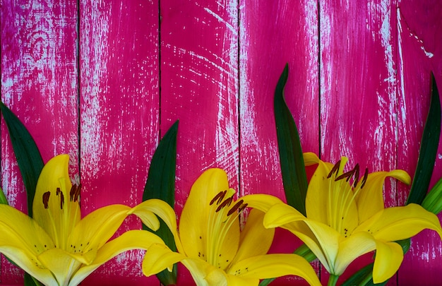 Lilies yellow on a vintage board