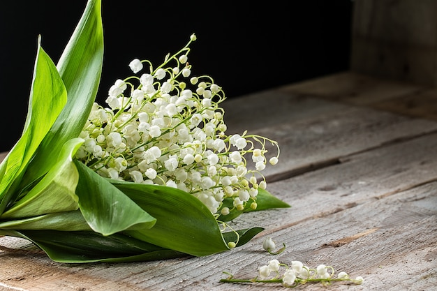 Lilly of valley  on wooden table. copy space