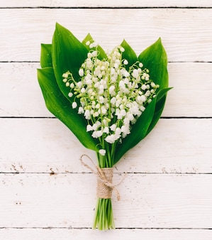 Lily of the valley bouquet on white boards