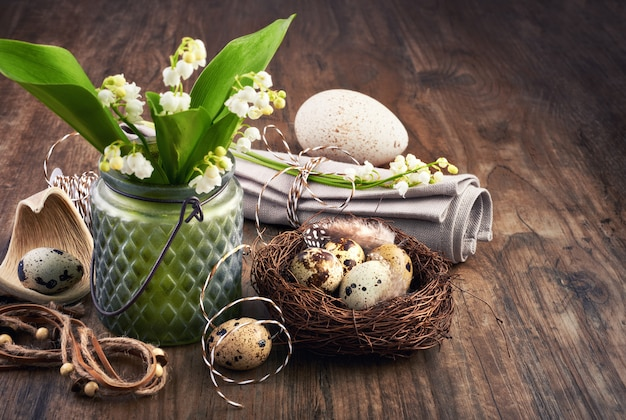 Lily of the valley and easter decorations on old oak wood