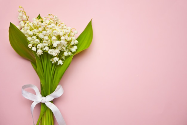 Lily of the valley flowers on pink background