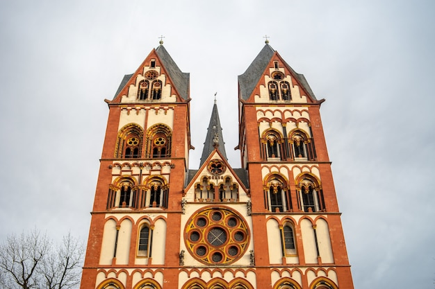 Limburg cathedral under a cloudy sky and sunlight in germany