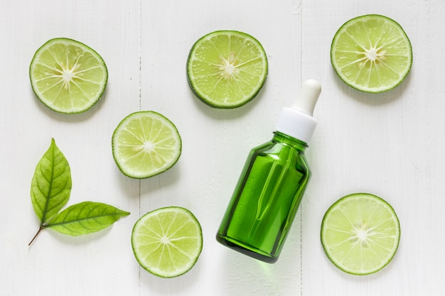 Lime extract with slices of lime and leaves