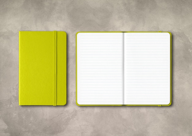 Lime green closed and open lined notebooks mockup isolated on concrete