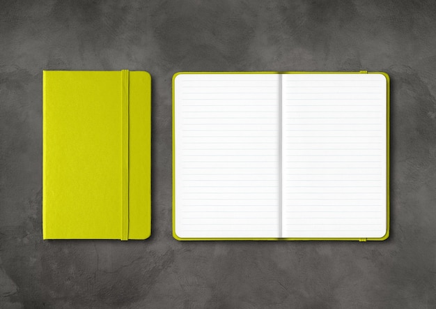 Lime green closed and open lined notebooks mockup isolated on dark concrete