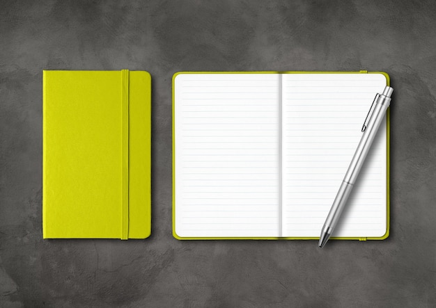 Lime green closed and open lined notebooks with a pen
