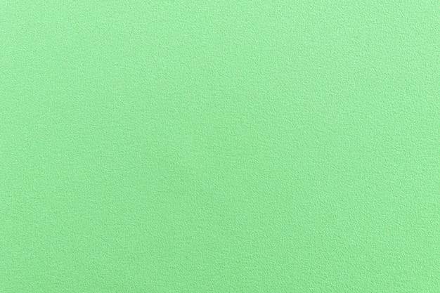 ライムグリーンのシームレス生地、上質な風合い。