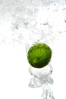 Lime is dropped into water