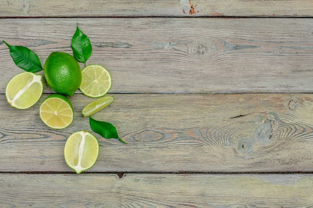 Lime juice with lime slices on wooden table.