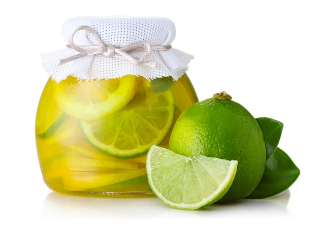 Lime and lemon jam with ripe fruits isolated on white