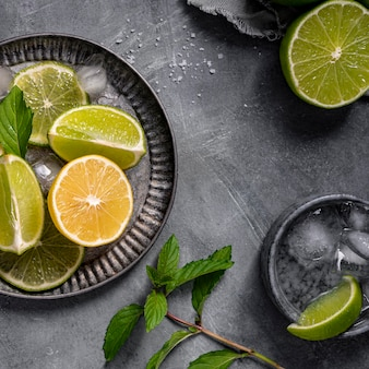 Lime and lemon slices on plate top view