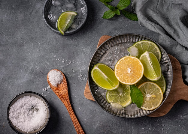 Lime and lemon slices on plate above view